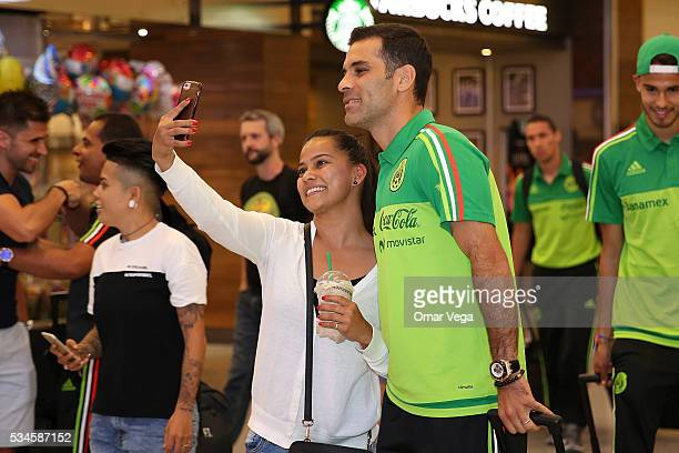 Rafael Marquez of Mexico poses for photos with a fan during the Mexico National Team arrival to United States at HartsfieldJackson International...