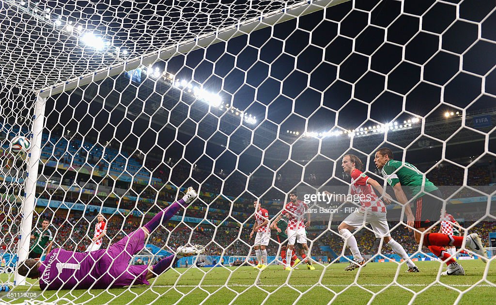 Rafael Marquez of Mexico scores the team's first goal during the 2014 FIFA World Cup Brazil Group A match between Croatia and Mexico at Arena Pernambuco on June 23, 2014 in Recife, Brazil.