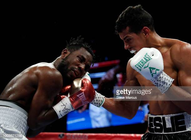Rafael Mensah of Ghana takes a punch from WBA super featherweight champion Alberto Machado of Puerto Rico during their title fight on July 21 2018 in...