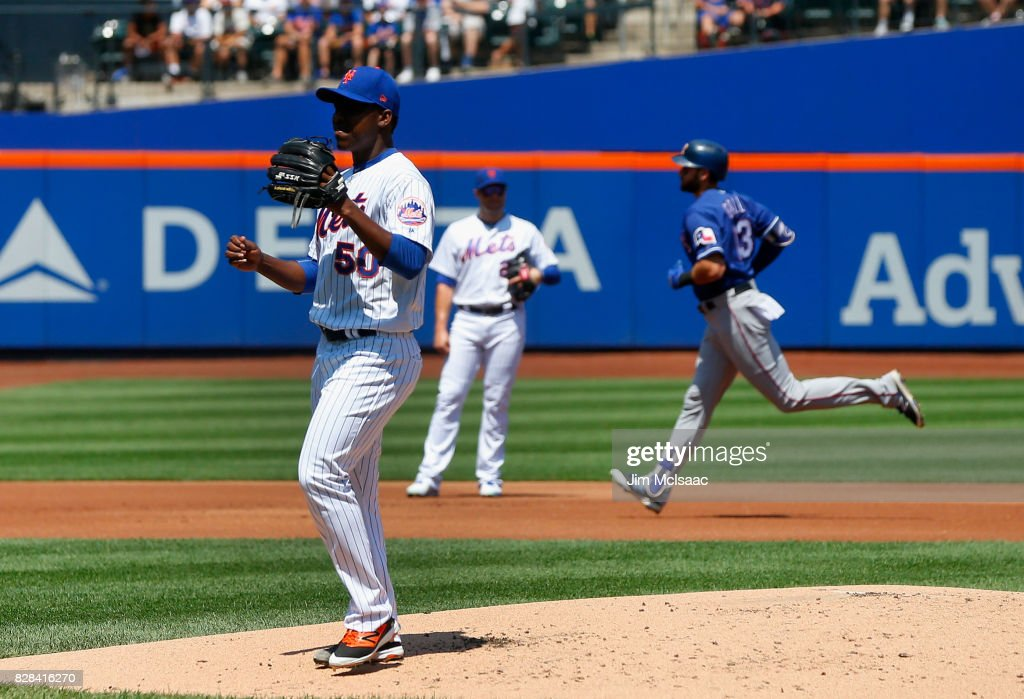 Rafael Montero #50 of the New York Mets waits for a new ball after surrendering a first inning two run home run against Joey Gallo #13 of the Texas Rangers at Citi Field on August 9, 2017 in the Flushing neighborhood of the Queens borough of New York City.