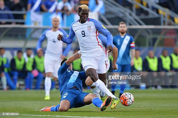 Rafael Morales of Guatemala slides in to kick the ball away from Gyasi Zardes of the United States Men's National Team in the first half during the...