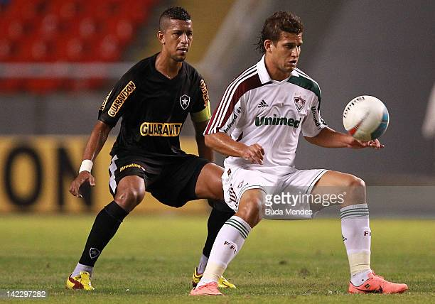 Rafael Moura of Fluminense struggles for the ball with Antonio Carlos of Botafogo during a match between Fluminense and Botafogo as part of Rio State...