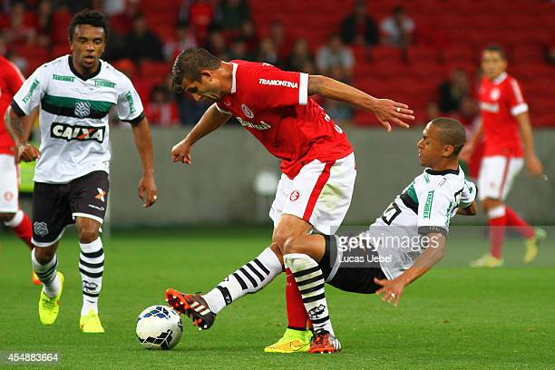 Rafael Moura of Internacional battles for the ball against Leandro Silva of Figueirense during match between Internacional and Figueirense as part of...