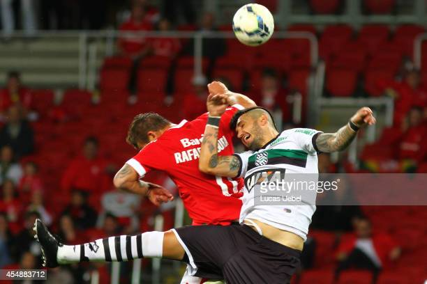 Rafael Moura of Internacional battles for the ball against Marquinhos of Figueirense during match between Internacional and Figueirense as part of...