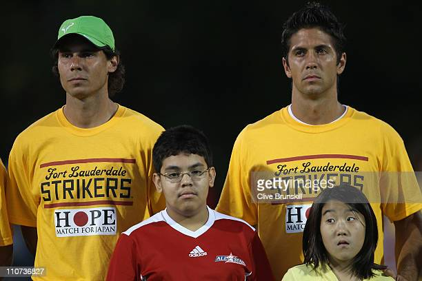 Rafael Nadal and Fernando Verdasco of ATP World Tour Allstars lines up for the Japanese national anthem before the Hope Match for Japan between ATP...