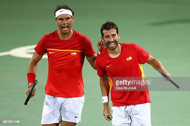 Rafael Nadal and Marc Lopez of Spain celebrate defeating Oliver Marach and Alexander Peya of Austria in a Men's Doubles Quarterfinals match on Day 4...