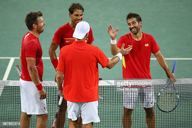 Rafael Nadal and Marc Lopez of Spain shake hands with Oliver Marach and Alexander Peya of Austria after a Men's Doubles Quarterfinals match on Day 4...