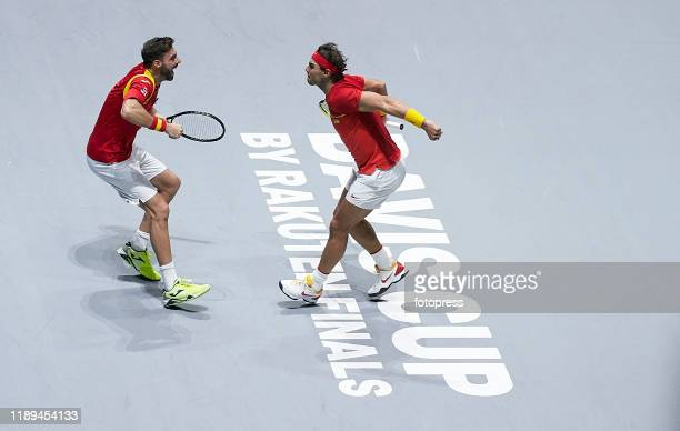 Rafael Nadal and Marcel Granollers of Spain celebrate their winning after the quarter final doubles match between Argentina and Spain during Day Five...