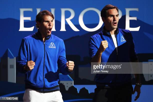 Rafael Nadal and Roger Federer of Team Europe celebrate as they watch the singles match between Denis Shapovalov of Team World and Dominic Thiem of...