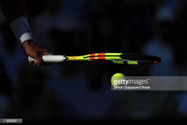 Rafael Nadal bounces the ball on his racket during his Gentlemen's Singles Semi Final match against Roger Federer on Day 11 of The Championships...
