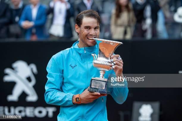 Rafael Nadal celebrates the victory biting the trophhy in his Mens Final match against Novak Djokovic during Internazionali BNL D'Italia Italian Open...
