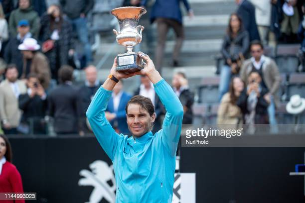 Rafael Nadal celebrates the victory with the trophy in his Mens Final match against Novak Djokovic during Internazionali BNL D'Italia Italian Open at...