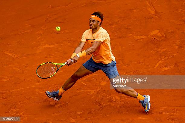 Rafael Nadal from Spain tries to reach a ball while playing against Andy Murray from Great Britain during a Madrid Open tennis tournament semifinals...