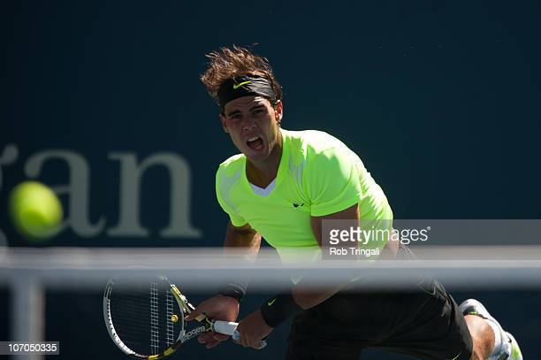 Rafael Nadal hits a return to Mikhail Youzhny on day thirteen of the 2010 US Open at the USTA Billie Jean King National Tennis Center on September 11...