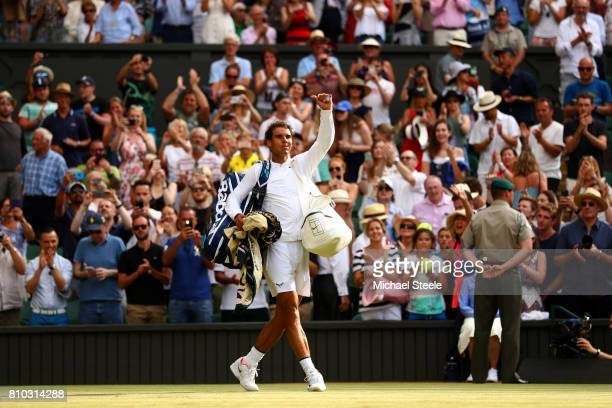 Rafael Nadal of Spain acknowledges the crowd as he celebrates victory after the Gentlemen's Singles third round match between Karen Khachanov of...