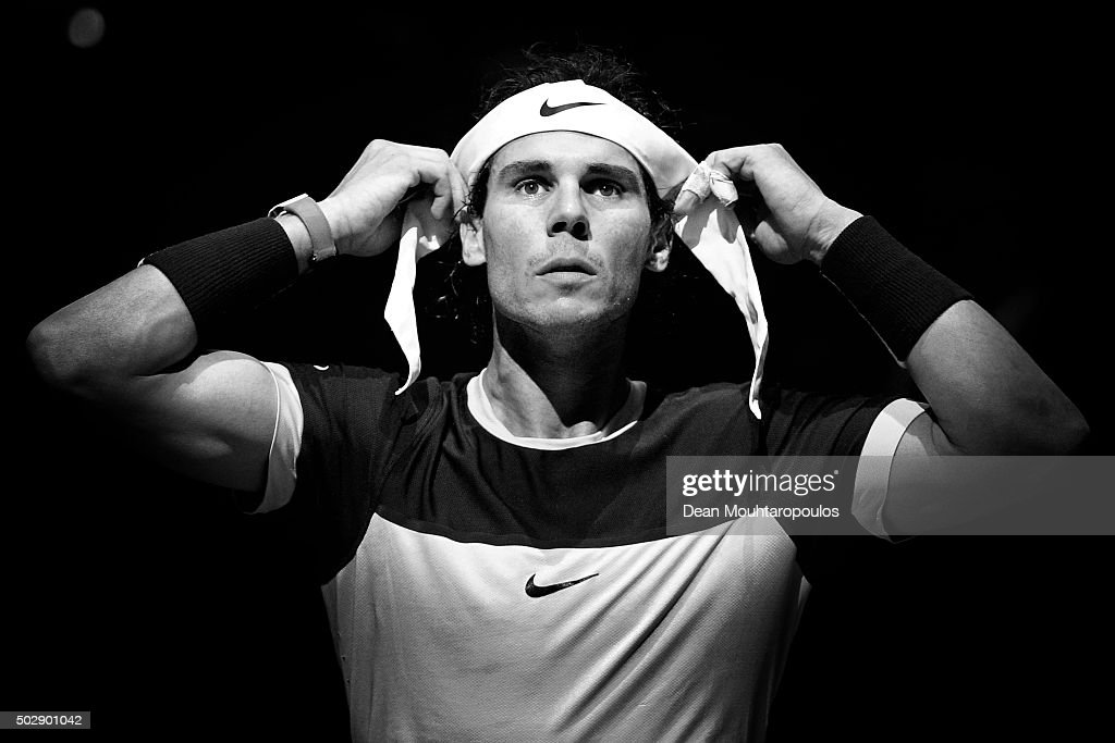 Rafael Nadal of Spain adjusts his headband between games in his match against Kevin Anderson of South Africa during Day 4 of the BNP Paribas Masters held at AccorHotels Arena on November 5, 2015 in Paris, France.