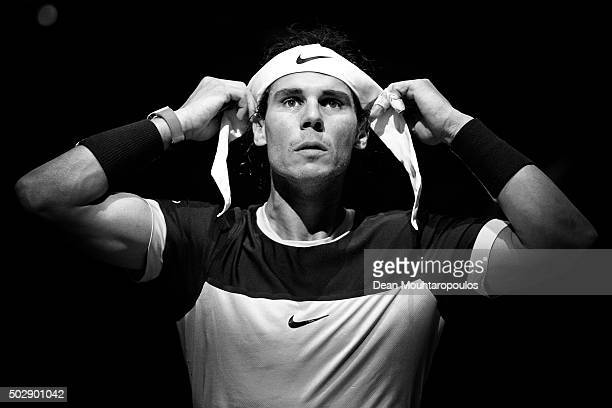 Rafael Nadal of Spain adjusts his headband between games in his match against Kevin Anderson of South Africa during Day 4 of the BNP Paribas Masters...