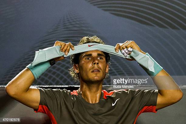 Rafael Nadal of Spain adjusts his headband in a match against Daniel GimenoTraver of Spain during the ATP Rio Open 2014 at Jockey Club Rio de Janeiro...