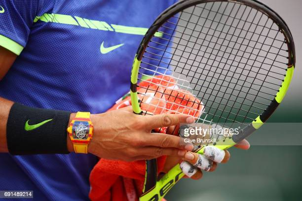 Rafael Nadal of Spain adjusts his racquet during the men's singles third round match against Nikoloz Basilashvili of Georgia on day six of the 2017...