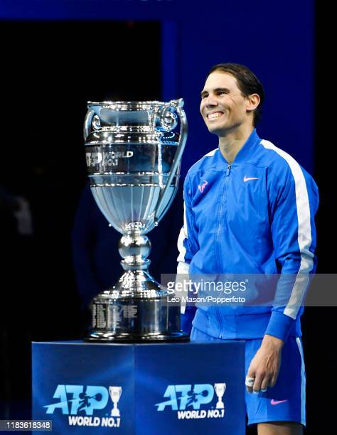 Rafael Nadal of Spain after receiving his trophy for being the ATP Tour End of Year World Number One following his singles match against Stefanos...