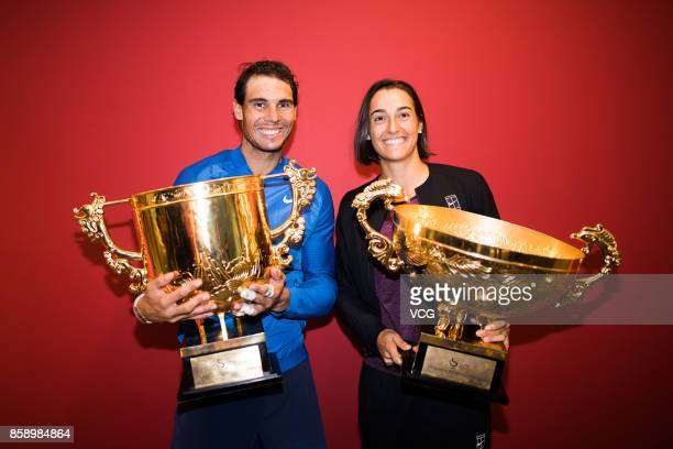 Rafael Nadal of Spain and Caroline Garcia of France pose with their trophies for a picture after the final matches on day nine of 2017 China Open at...