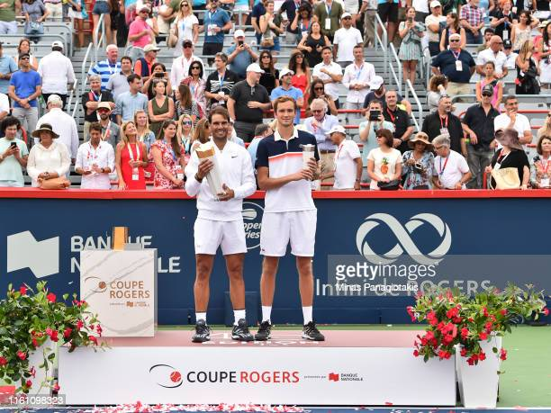 Rafael Nadal of Spain and Daniil Medvedev of Russia pose with their trophies during the mens singles final on day 10 of the Rogers Cup at IGA Stadium...