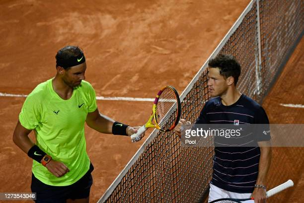 Rafael Nadal of Spain and Diego Schwartzman of Argentina interact at the net after their quarterfinal match during day six of the Internazionali BNL...