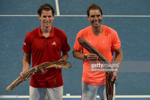 Rafael Nadal of Spain and Dominic Thiem of Austria pose for pictures after their match during the 'A Day at the Drive' exhibition tournament in...