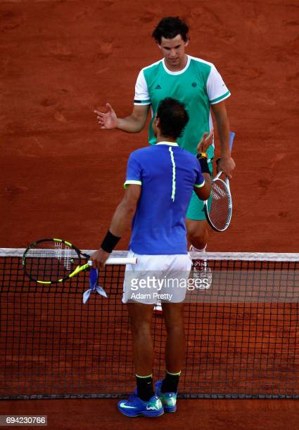 Rafael Nadal of Spain and Dominic Thiem of Austria shake hands following their mens singles semifinal match on day thirteen of the 2017 French Open...