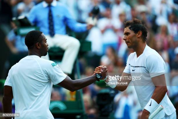 Rafael Nadal of Spain and Donald Young of The United States shake hands after their Gentlemen's Singles second round match on day three of the...