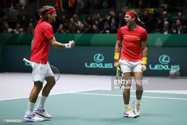 Rafael Nadal of Spain and Feliciano Lopez of Spain celebrate after winning the first set in their semifinal doubles match against Jamie Murray and...