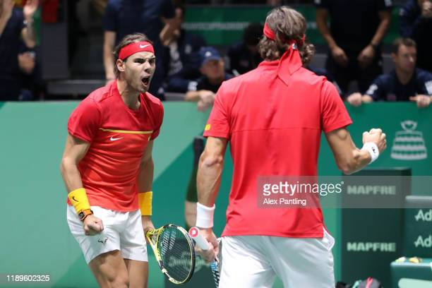 Rafael Nadal of Spain and Feliciano Lopez of Spain celebrate holding a serve in their semi-final doubles match against Jamie Murray and Neal Skupski...