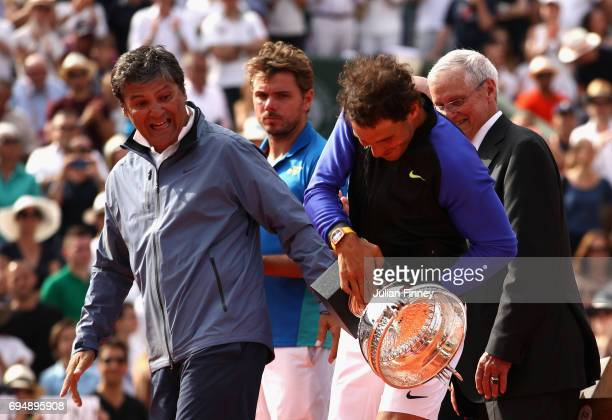 Rafael Nadal of Spain and his coach Toni Nadal pose react following victory in the mens singles final against Stan Wawrinka of Switzerland on day...