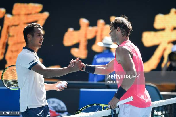Rafael Nadal of Spain and Hugo Dellien of Bolivia embrace at the net following their Men's Singles first round match on day two of the 2020...