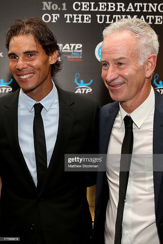 Rafael Nadal of Spain and John McEnroe pose for photographers before the ATP Heritage Celebration at The Waldorf=Astoria on August 23, 2013 in New York City.