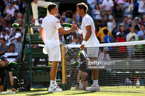 Rafael Nadal of Spain and John Millman of Australia shake hands after their Gentlemen's Singles first round match on day one of the Wimbledon Lawn...
