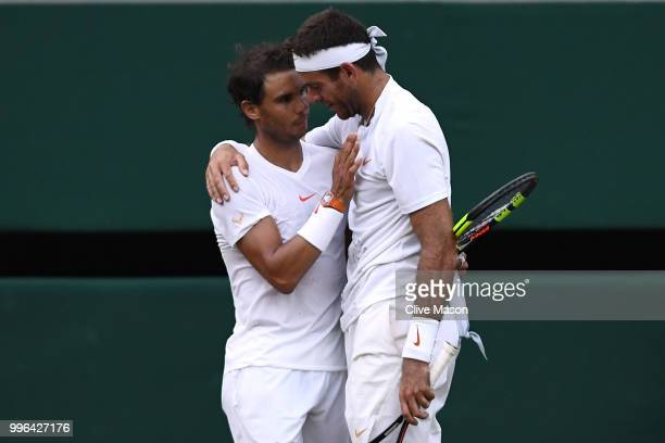 Rafael Nadal of Spain and Juan Martin Del Potro of Argentina embrace following their Men's Singles QuarterFinals match on day nine of the Wimbledon...