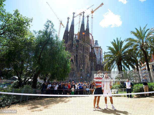 Rafael Nadal of Spain and Kei Nishikori of Japan pose and play tennis in front of the Sagrada Familia to promote the ATP 500 World Tour Barcelona...
