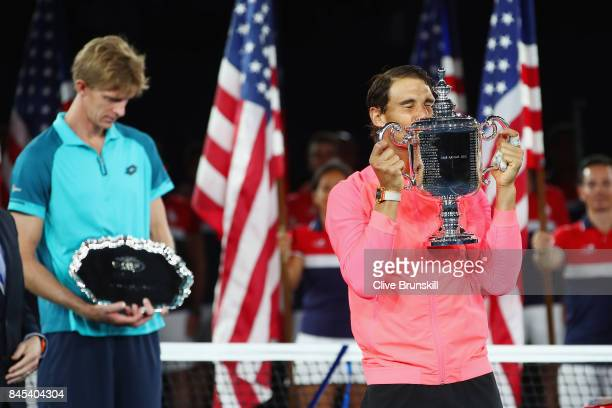 Rafael Nadal of Spain and Kevin Anderson of South Africa pose during the trophy ceremony after their Men's Singles Finals match on Day Fourteen of...