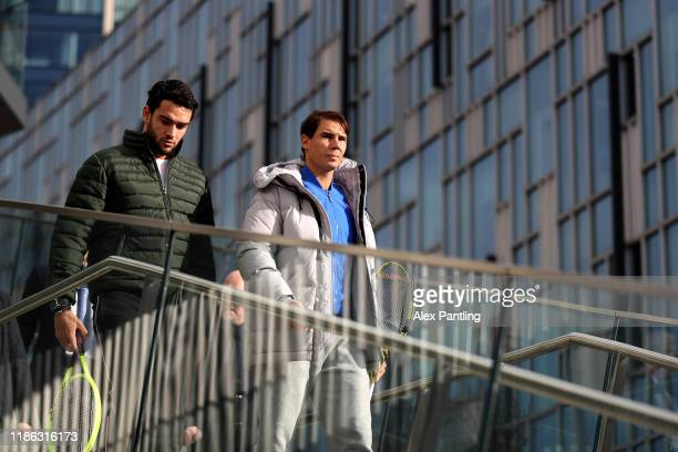 Rafael Nadal of Spain and Matteo Berrettini of Italy arrive during previews for the Nitto ATP Finals at The O2 Arena on November 08 2019 in London...