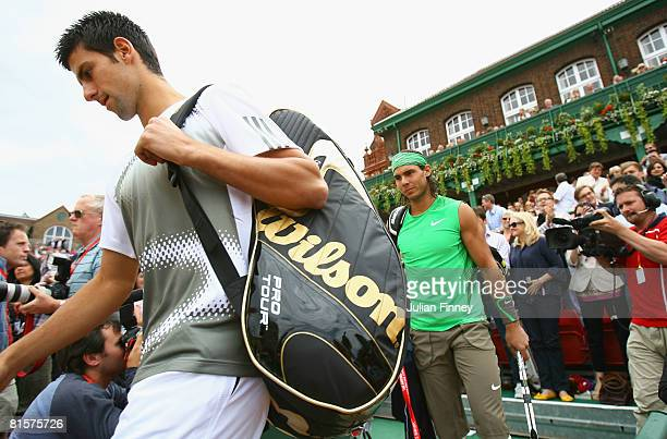 Rafael Nadal of Spain and Novak Djokovic of Serbia arrives before the Men's Singles Final match on Day 7 of the Artois Championships at Queen's Club...
