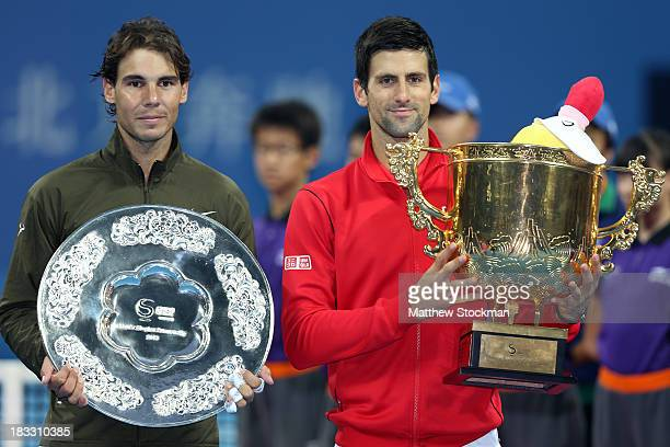 Rafael Nadal of Spain and Novak Djokovic of Serbia pose for photographers at the trophy ceremony during the final of the 2013 China Open at the...