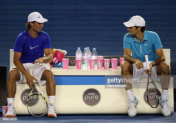 Rafael Nadal of Spain and of the Blue Team talks with Roger Federer of Switzerland and of the Red Team during the 'Hit For Haiti' charity exhibition...
