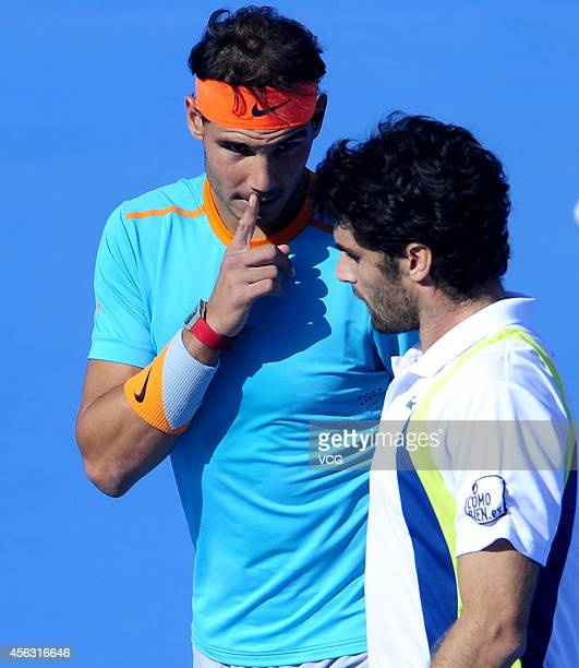 Rafael Nadal of Spain and Pablo Andujar of Spain compete with Tomas Berdych of Czech and John Isner of USA during day 3 of 2014 China Open on...