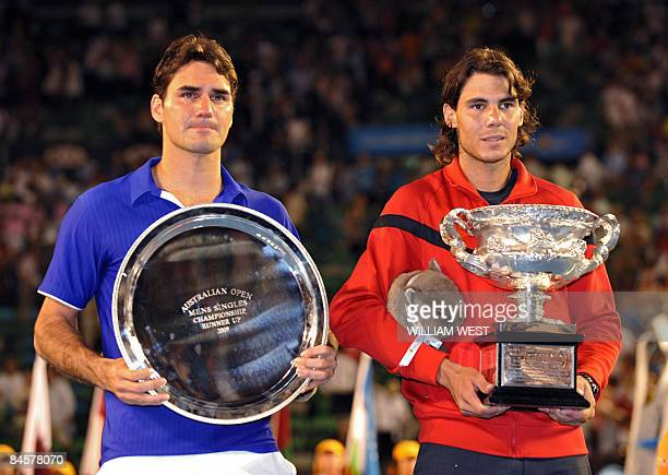 Rafael Nadal of Spain and Roger Federer of Switzerland attend the trophy presentation after the men's tennis final on day 14 of the Australian Open...