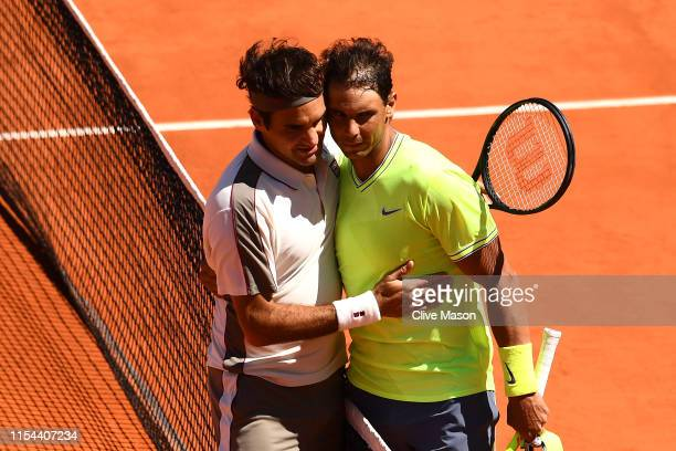 Rafael Nadal of Spain and Roger Federer of Switzerland embrace at the net after their mens singles semi-final match during Day thirteen of the 2019...