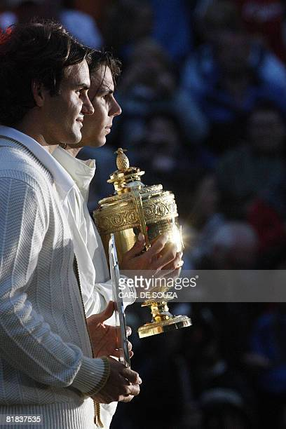 Rafael Nadal of Spain and Roger Federer of Switzerland hold their respective trophies after Nadal beat Federer 64 64 67 67 97 in the Men's Singles...
