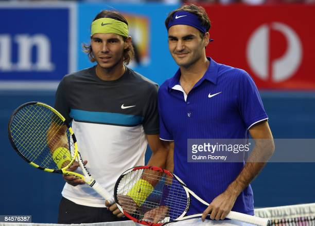 Rafael Nadal of Spain and Roger Federer of Switzerland pose for photographers before their men's final match during day fourteen of the 2009...