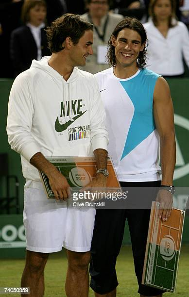 Rafael Nadal of Spain and Roger Federer of Switzerland share a joke after the The Battle of the Surfaces between Rafael Nadal and Roger Federer at...