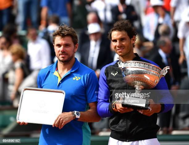 Rafael Nadal of Spain and Stan Wawrinka of Switzerland hold their trophy after the final match at the Roland Garros stadium in Paris France on June...